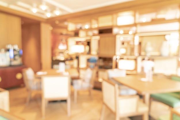 背景の抽象的なぼかしと焦点がぼけたホテルのレストラン