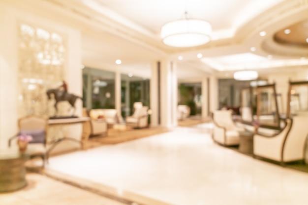 抽象的なぼかしと焦点がぼけた高級ホテルのロビー