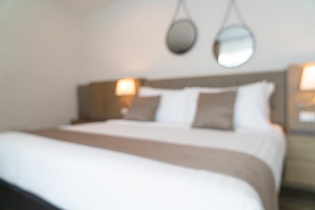 背景の抽象的なぼかし美しい高級ホテルの寝室のインテリア