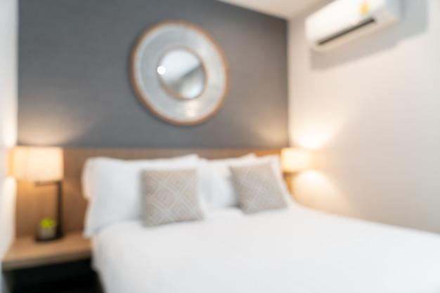 抽象的なぼかし美しい高級ホテルの寝室のインテリア
