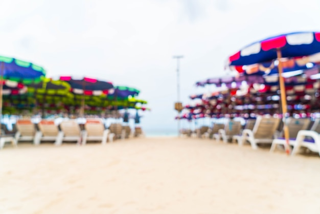 Abstract blur beautiful luxury umbrella and chair on sea and beach