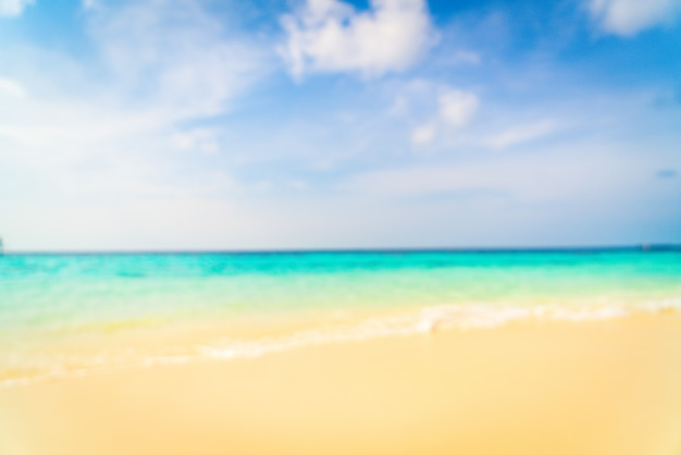 Abstract blur beautiful tropical beach sea and blue sky for background