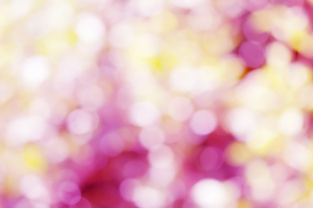 Abstract blur bokeh light pink and yellow soft pastel color wallpaper background.