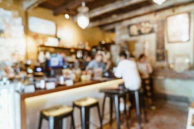 背景の抽象的なぼかしコーヒーショップカフェとレストラン