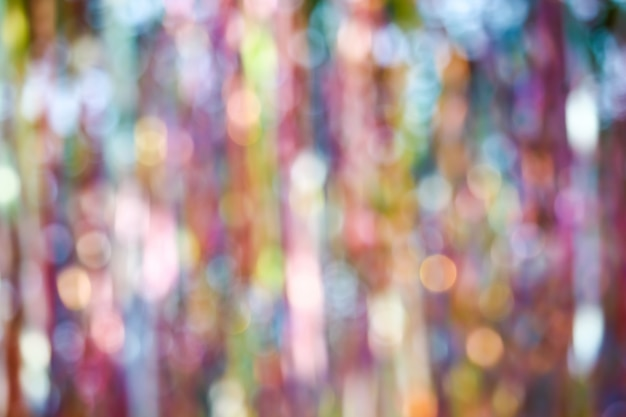 Abstract blur of colorful ribbon rainbow on ceiling