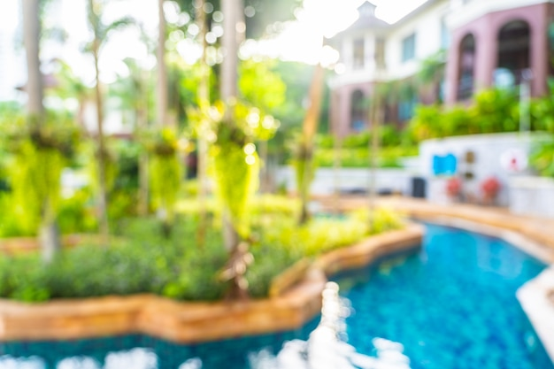 Abstract blur and defocus beautiful outdoor swimming pool in hotel resort, blurred photo background