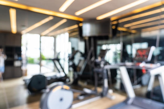 Abstract blur and defocused fitness equipment in gym interior, blurred photo background