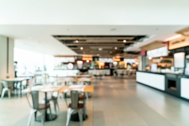 Abstract blur and defocused food court center in shopping mall