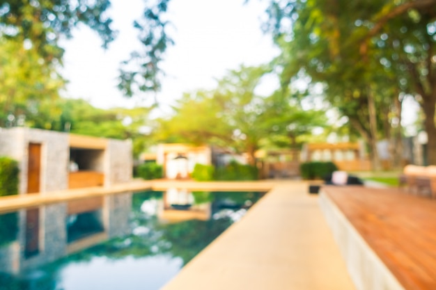 Abstract blur defocused swimming pool in luxury hotel resort
