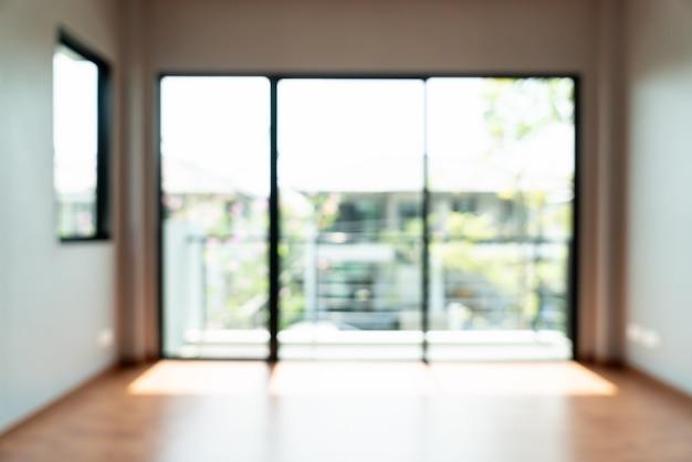 抽象的なぼかし窓と家のドアと空の部屋