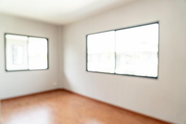 Абстрактный размытия пустая комната с окном и дверью в доме