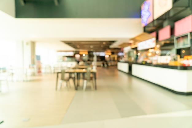 Abstract blur food court in shopping mall for background