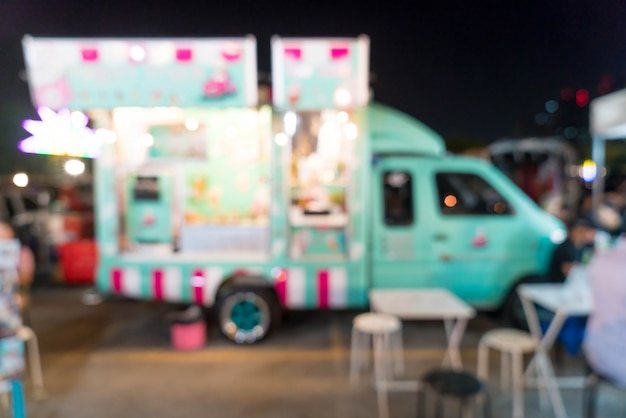 Abstract blur food truck at night street market in thailand