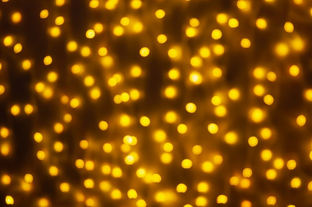 Abstract blur golden bokeh light christmas holiday background
