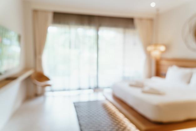 背景の抽象的なぼかしホテルの寝室のインテリア
