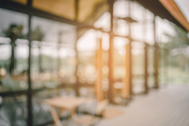 Abstract blur image of coffee shop and sun light