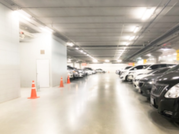 Abstract blur  image of many cars in parking garage interior at department store or shopping mall