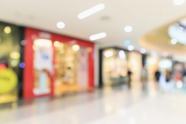 抽象ぼかし現代のショッピングモール店のインテリアの焦点がぼけた背景