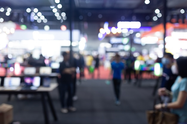 Abstract blur people in exhibition hall event trade show expo business convention show, job fair, or stock market. organization or company event, commercial trading