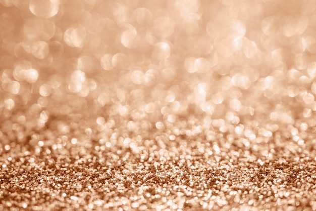 Abstract blur rose gold glitter sparkle defocused bokeh light background