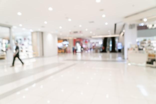 背景の抽象的なぼかしショッピングモールと小売店