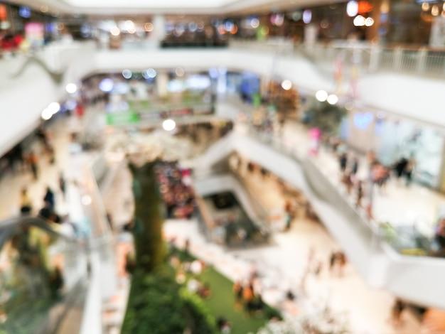 抽象的なぼかしの背景のデパートインテリアのショッピングモール。本堂ショッピングモールのぼやけた画像のインテリア。