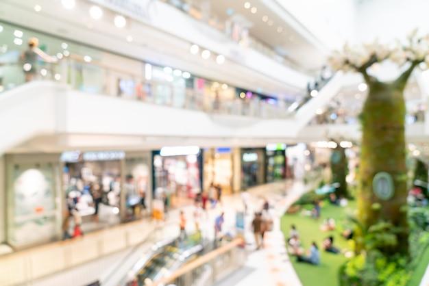 抽象的なぼかしの背景のショッピングモールやデパートのインテリア