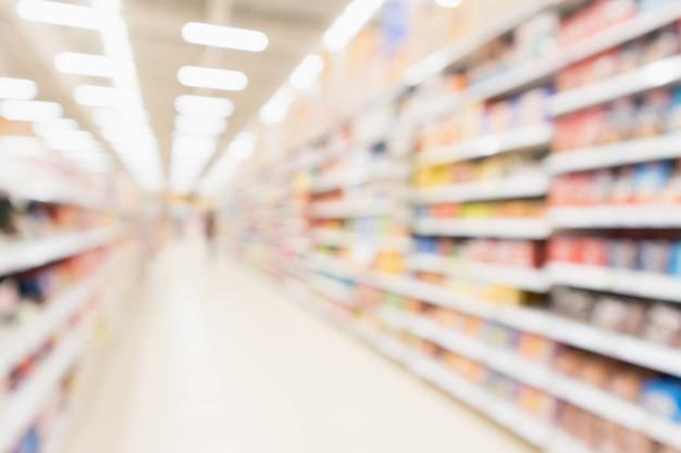 추상 흐림 슈퍼마켓 할인 매장 통로 및 제품 선반 인테리어 defocused 배경