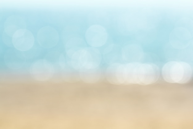 Abstract blur tropical beach with beauty bokeh under sunlight on wave