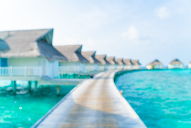 Abstract blur tropical maldives resort hotel and island with beach and sea for background