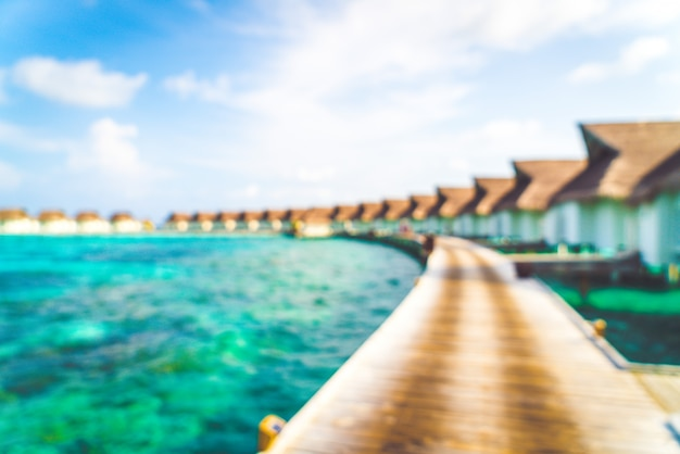 Abstract blur tropical maldives resort hotel and island with beach and sea