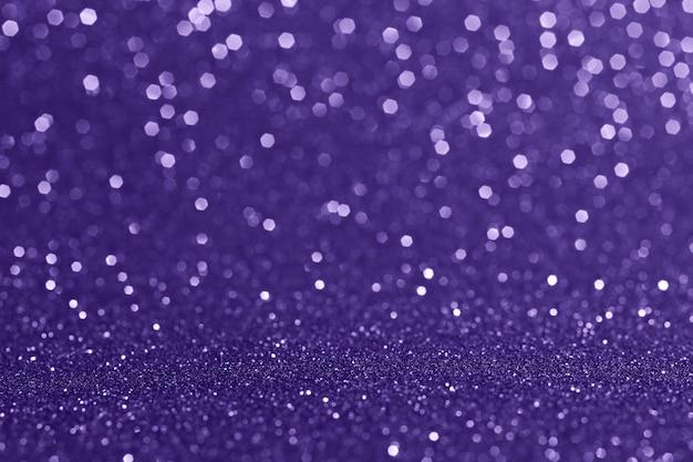 Абстрактный размытый фон. сверкающее боке. блеск текстуры. выдающийся ультрафиолетовый цвет.