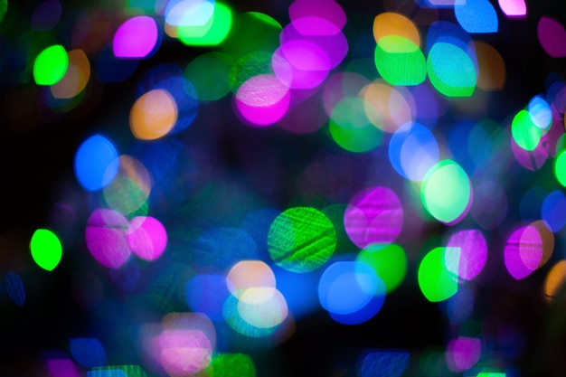 Abstract blurred background with numerous colourful bright festive bokeh.