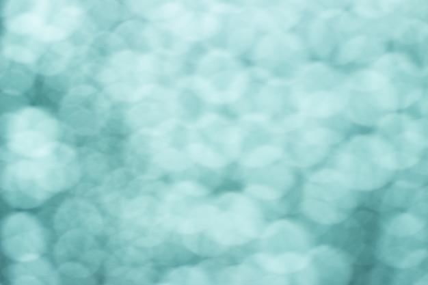 水滴から抽象的なぼやけたボケ背景