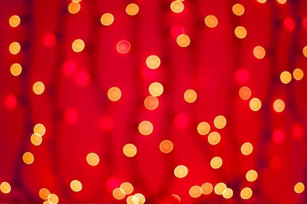 赤の抽象的なぼやけたボケライト