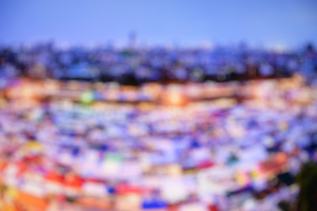 Abstract blurred cityscape building street food market background.