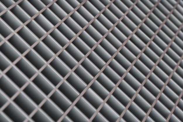 金属から抽象的なぼやけた斜めの格子の背景