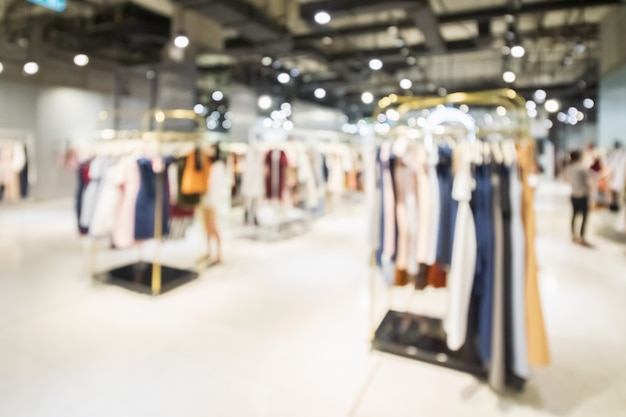 Abstract blurred of fashion clothes shop boutique interior in shopping mall