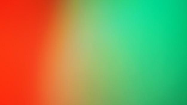 抽象的なぼやけたグラデーションの背景。マルチカラーオレンジレッドとミントグリーン色の背景。バナーテンプレート。