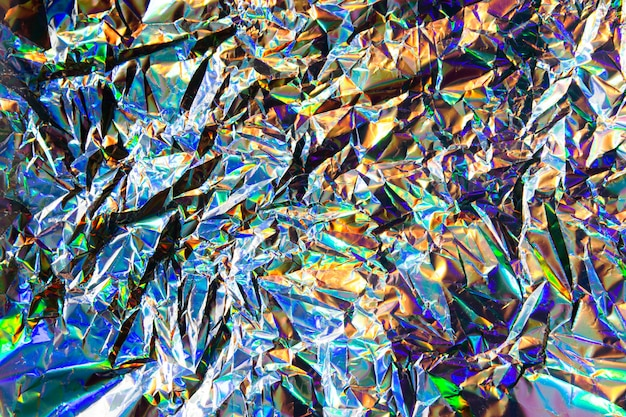 Abstract blurred holographic iridescent mermaid foil texture background. futuristic neon trendy silver colors