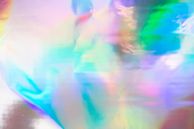 Abstract blurred holographic iridescent mermaid foil texture.