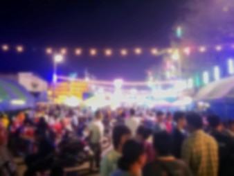 Abstract Blurred image of Night Festival on street with light bokeh