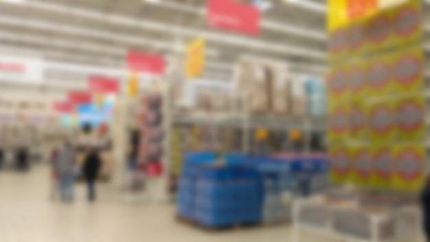 ボケ味のあるショッピングモールの人々の抽象的なぼやけた画像