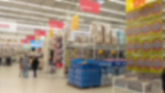 Abstract blurred image of people in shopping mall with bokeh