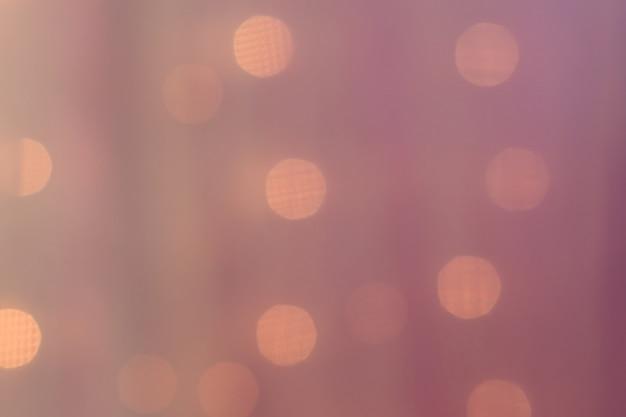 バイオレット色の背景に抽象的なぼやけたライト