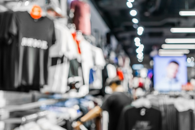 Abstract blurred of a man shopping in fashion clothes shop