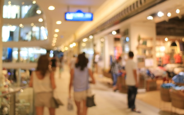 Abstract blurred people enjoy shopping inside a department store
