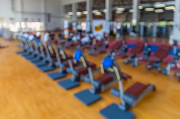 Abstract blurred photo of fitness gym background, sport concept