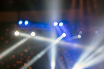 Abstract blurred photo of spotlight in conference hall