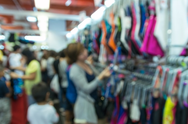 Abstract blurred photo of store blur with customer choose product bokeh background